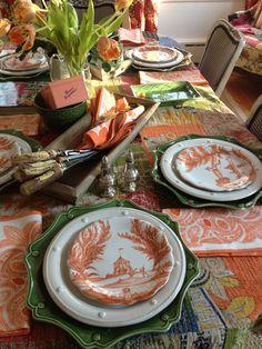 Orange and green tablescape. Juliska pumpkin country estate party plates. Juliska chargers, dinner plates and napkins.