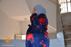 27-year-old Ralia is Syrian refugee about to give birth. She lives with 37 other refugee families in a school.
