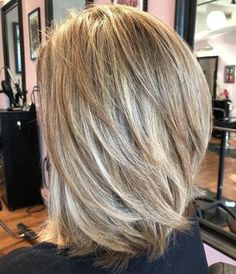 70 Brightest Medium Layered Haircuts to Light You Up, Frisuren, Lob With Angled Layers Throughout. V Cut Layers, Medium Length Hair Cuts With Layers, Medium Hair Cuts, Short Hair Cuts, Medium Hair Styles, Short Hair Styles, Medium Length Bobs, Hair Layers, Pixie Cuts