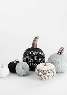 • black, white and turquoise decorated pumpkins •