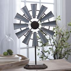 Looking for an on-trend piece to transition your home's style to being farmhouse chic? The 'Galvanized Windmill Finial' is a great place to start.