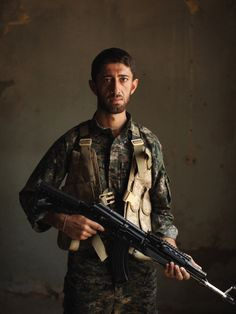 Kamal Khalo, 26 | PHOTO ESSAY THE SOLDIERS OF SINJAR Forced from their homes, a ragtag group of Kurdish mountain men are headed home to fight the Islamic State to the death. PHOTOGRAPHS BY ANDREW QUILTY