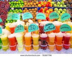 Colorful fruit juices in La Boqueria (Barcelona famous marketplace) by Ingrid Prats, via ShutterStock