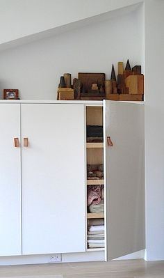 studio storage but still have display space -- access to the plug under the shelf