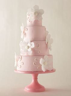 Jennifer Jones's blush-pink cake, which echoes the wedding invitation of one of her clients, walks just the right line between girly and elegant. Fondant cake with paper-wafer flowers, $7 per slice, Icing on the Top, Tulsa, OK; stand, Sarah's Stands