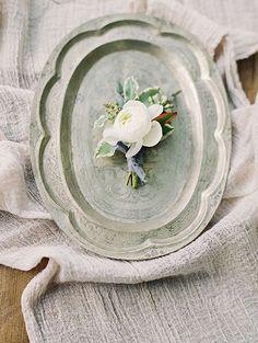 Ranunculus Boutonnieres for a Winter Wedding | Brides.com