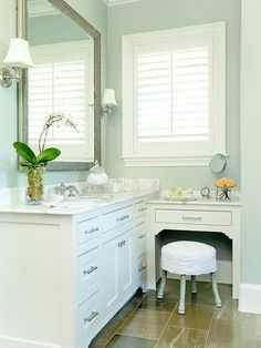 White plantation shutter with decorative frame and window sill/ledge. www.sunkistshutters.com