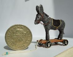 Another example of a traditional pulltoy in 1:12 scale - this time a donkey created out of Fimo dough and textiles - very clever! | source: Amber's House