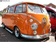 vintage orange volkswagen bus. haha. i used to drive my kids around in one of these. hippy mama.