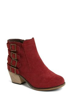 Adoring the buckles on this red bootie.