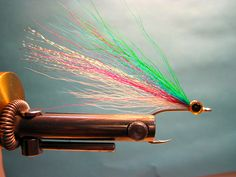 """Jay Nicholas demonstrates how to tie another salmon pattern. Surf or estuary this pattern can be a killer """"mini baitfish"""" pattern for fresh Chinook or Coho salmon."""