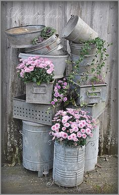 Galvanized containers for the Garden.  I love the one in front with the curly legs!