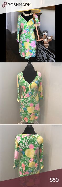 Hibiscus Stroll V-Neck Palmetto Dress Nothing screams true prep like Lilly Pulitzer. This bright and bold palmetto dress is a signature Lilly must-have look. This dress is perfect for going for a morning coffee run, wearing to the beach, lunch at the golf club, or with a pair of heels dinner at the yacht club. Perfect for vacation travel or to look like everyday is a vacation. Gold buttons a neck line and 3/4 length sleeves with cuff detail. Great condition 🌴🌴 Lilly Pulitzer Dresses
