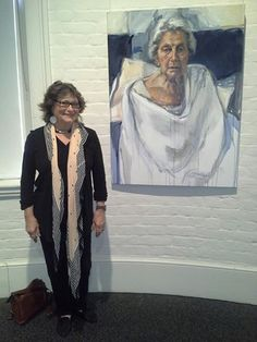 Ann Cape with the portrait of her mother, at the Portia Geach Memorial Award 2014