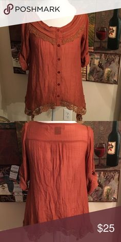 RUST BUTTON UP TOP SZ M 3/4 sleeve. Lace details. Rust Button up Top sz M. 3/4 Sleeves with lace across the chest and around the bottom of the top. Urban Mango Tops Button Down Shirts