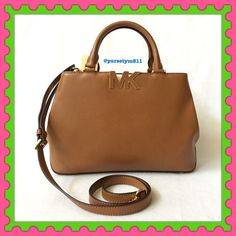 """🎉HOSTPICK🎉Authentic Michael Kors Leather Handbag 💯% AUTHENTIC ✨ Beautiful leather handbag from Michael Kors 🌹 Very versatile. Crossbody, top handle & shoulder bag. Lightweight & very spacious. Length 12"""" Height 8 1/4"""" Width 4 1/2"""" w/ adjustable & detachable long strap. Color: Luggage with yellow gold tone hardware. 5 interior pockets w/ a big middle compartment. Gorgeous 💖 NO TRADE 🙅🏼 Michael Kors Bags Satchels"""