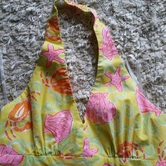 Halter sundress lily Pulitzer Yellow,  pink, orange  seashells, and starfish  Lilly halter  worn once ...too big. Everything to love about Lily! Lilly Pulitzer Dresses