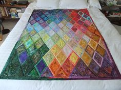 Bordered Diamonds  What was your inspiration?  Saw a picture of some Kaffe Fassett designed quilts and decided to try this one - 600 pieces in this lap sized quilt - can't imagine how many in a full sized quilt! Again, my intention was to explore a colour progression, including the binding.