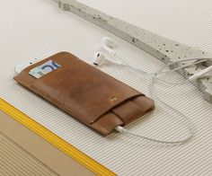 Combine your wallet and phone for easy carrying with the Slim Fit Vintage Leather #iPhone #Wallet & #Sleeve by Alexej Nagel.