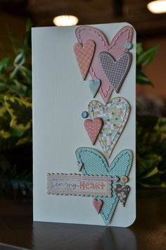 Cards, I do want to try sewing and card but I don't have a sewin machine and I don't know how well the card would survive with how I might end up pressing and forcing a needle through.