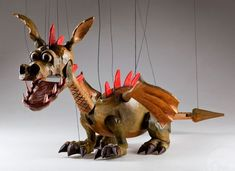 Our beautiful Dragon Spike Marionette is going to draw you into his world full of magic, legends and fairy tales. Dragon Spike is handmade original and he will make you Lion Dragon, Dragon Puppet, Dragon Egg, Puppet Costume, Marionette Puppet, Wooden Puppet, Beautiful Dragon, Egg Carton Crafts, Finger Puppets