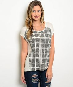We adore this comfortable scoop-neck cream top with a black check design on the front! The cut of the short sleeve is so slimming and the fabric is ridiculously comfortable. You'll find that this top will quickly become your go-to piece!  95% Rayon 5% Spandex  Available in S, M, L