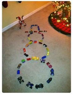 Elf on the shelf makes a snowman out of hot wheels