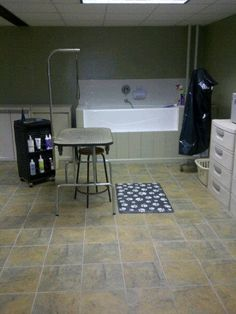 my dream dog room.  except mine would have more cute dog posters on the wall. note the amazing raised tub.