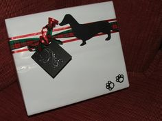 DIY gift wrapping ribbon - Dachshund Doggie Silhouette Gift Wrap.pattern at http://www.craftsy.com/pattern/sewing/other/dachshund-dog-pdf-applique-template/25738 . Dog and tag and paw prints cut from old Christmas Card. http://www.pinterest.com/bethob/wrap-it-up-with-a-little-whimsy/