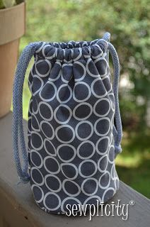 instead of a bulky camera case for day to day use, sew this easy lense bag so you can easily slide lenses into your purse!