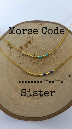 These dainty morse code necklace spell out SISTER. Gold plated beads and tiny crystal beads are used as dots and dashes. Its the perfect gift to express your feelings or how much the other person means to you.  Very cute and simple.  Lobster clasp end.  The order includes:  - set of 2 morse code necklace SISTER  - 2 cards with your secret message.  There are multiple colors. Choose the one you like!!(The colors of the main picture are royal blue and turquoise)   Available; - lengths : 14(…
