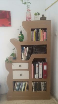 Picture of Recycled cardboard bookshelf -  laser cut and handwork