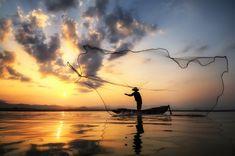 Fisherman of Bangpra Lake in action when fishing, Thailand. - Fisherman of Bangpra Lake in action when fishing, Thailand.