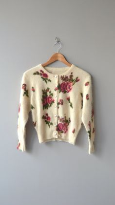 Fetching ultra soft and fuzzy angora cardigan with romantic floral motif. ✂-----Measurements  fits like: small/medium bust: up to 41 waist: up to 33 sleeve: 22 length: 21 brand/maker: n/a condition: excellent  ✩ more vintage coats ✩ http://www.etsy.com/shop/DearGolden?section_id=5800175  ✩ visit the shop ✩ http://www.DearGolden.etsy.com  _____________________ ✩ www.deargolden.com ✩ twitter: deargolden