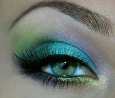 mermaid makeup! very pretty! (this is a little simpler and wouldn't involve getting stuff to stick to her face!-L)