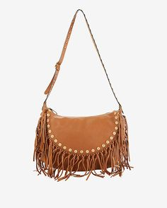Valentino Medallion Fringe Hobo: Tan: Fringe detailing and gold-tone medallions trim take this grained leather hobo bag to whole new level of boho chic. Adjustable shoulder strap. Zip top closure. Interior pockets and zip pocket. Measures: 16.5 W x 12 H x 3 D. In tan. Made in ...