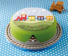 All aboard this train cake for an introduction to the techniques needed to build up a simple sugar landscape and create a treat a young one is going to love. Bithday Cake, Cute Birthday Cakes, Doraemon Cake, Christening Cupcakes, Clown Cake, Thomas Cakes, Snowman Cake, Cake Shapes, Cake Craft