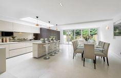 Neutral kitchen with bifold doors #openplankitchen #bifolddoors #contemporarykitchen