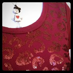 Burgundy Blouse New, never worn. Pretty burgundy blouse with sequins and ruching at the bottom/sides.   Sadly, I gained weight before being able to use it. My loss, will hopefully be your gain. ??  95% Polyester 5% Spandex  Sorry, no trades. Lavish Tops Blouses