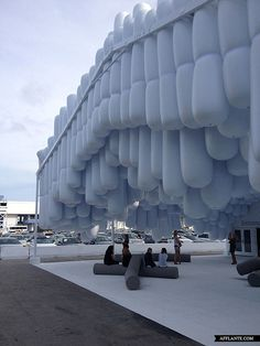 """This floating environment cascades through the Pavilion entrance at the 8th Design Miami.  Designed by Snarkitecture, the """"Drift"""", as it is titled, incorporated reductive design methodology to create an unexpected ambiance for visitors within the space.  The entrance, containing several hundred cylinders, creates paths for circulation, varying in height and allowing natural light to filter through."""