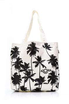 "This reversible tote will take you from the beach to the bar or from the pool to the plane. Perfect for your damp bikini board shorts yoga and work-out clothes. Reverse side is white with the Aloha Collection logo printed in black.  Reversible tote measures: 17"" across the top x 5.5"" wide x 13"" tall  Palms Reversible Tote by Aloha Collection. Bags - Beach Ready Montauk The Hamptons New York"