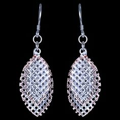Silver earrings, leaf, gold plated Silver earrings, Ag 925/1000 - sterling silver. Rhodium finished. Red gold-plated. Very nice, compelling work. The earrings consists of several netted leaves. Attractive jewelry. Dimensions approx. 15x45mm including enclosure. Price per pair.