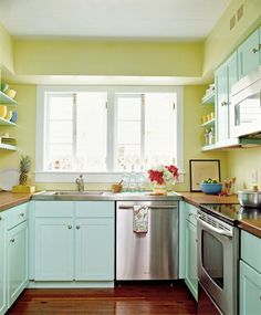 Yellow and teal kitchen with bright blue and orange or green accents.  Paint cabinets teal and walls a sunflower color.  Stainless appliances.  Need a kitchen window to make this work, I think.