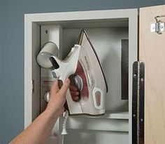 Iron-A-Way - Premium Swivel Ironing Center - Unfinished Wood Exterior - 46 inch spring activated ventilated metal ironing board. 90 degree left or right swivel. Primed Doors, Iron Board, Safety Switch, Installation Manual, Extruded Aluminum, Storage Shelves, Iron Storage, Wood Doors, Container Houses