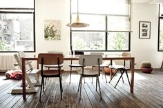 A vintage inspired Brussels home. Love the weathered-looking wood floors. Simple lines