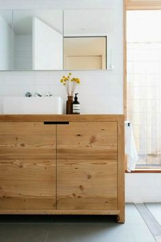 Northcote Home | Plum Pretty Sugar. white subway tiles, wood vanity