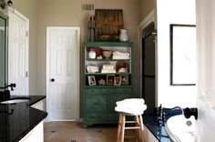 What I love most about this photo is that it shows how a piece of furniture can be painted, put in a unique room and given a new lease on life.  Look around your home and see if anything is screaming to be repurposed! Farmhouse Bathroom by Corynne Pless