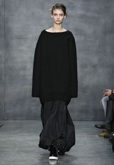 LOOK 35. Black bonded wool ribbed knit oversized pullover. Black taffeta bubbled maxi skirt.