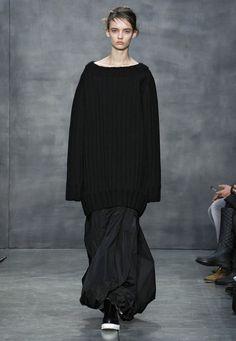 LOOK 35. Black bonded wool ribbed knit oversized pullover. Black taffeta bubbled maxi skirt.