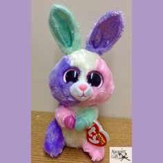 Getting ready for Easter with this colourful Bunny from TY now in stock at Magpies Gifts Lisa Frank Unicorn, Magpies Gifts, Beanie Boos, Cool Toys, Bunny, Plush, Easter, Christmas Ornaments, Wallpaper